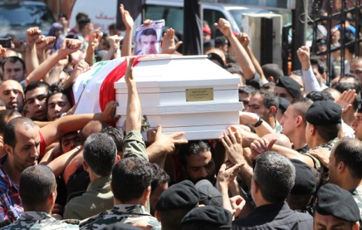Mourners and comrades carry the coffin of Abdel Karim Hodroj, a 20-year-old Lebanese General Security agency inspector who was killed the previous day in an overnight suicide blast, during his funeral, in Beirut's southern suburb of Shiyah. The overnight suicide blast in Beirut's southern suburbs, killed the security officer who had tried to stop the bomber, the General Security agency said. (ANWAR AMRO / AFP)
